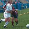 Tribune-Star/Joseph C. Garza<br /> Corner collision: Indiana State's Katlin Owens and IUPUI's Margaret Allgeier appear to hug as they collide for possession of the ball during the Sycamores' match against the Jaguars Sunday at Memorial Stadium.
