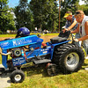 Tribune-Star/Jim Avelis<br /> Joint effort: Connie Hinsenkamp and Bill Flowers push Bill's tractor to get it certified for the pulling competition at the Fontanet bean dinner last month.