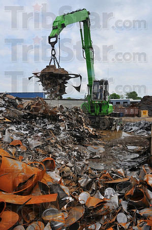 Making room: Crane operator  uses an electro magnet to pick up scrap for loading onto a truck. The trucks can each hold 20 tons of scrap. A lot of what Goodman and Wolfe deals in is industrial scrap.