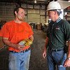 People person: Steve Dickerson chats with Goodman & Wolfe general manager Tom Haley after getting his scrap weighed. Haley works in all aspects of the operation including driving 20-ton loads of scrap to refineries.