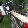 Good find: Charles Farner wrestles a discarded gas stove into the bed of his truck. Farner paid $300 for the truck about 3 years ago. After a $500 transmission and $100 to get it installed, Farner have cruised most of the alleys in Terre Haute,  collection discarded metals for their scrap value. The floods of last June proved a boone to him and others like him allowing him to make money as a trash hauler, hauling sodden furniture and drywall to the landfill.