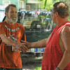 Everybody wins: Dennis Orlando thanks Charles Farner for taking scrap metal off his hands. Farner is careful to always check with home owners  when he's not sure an item has ben discarded.