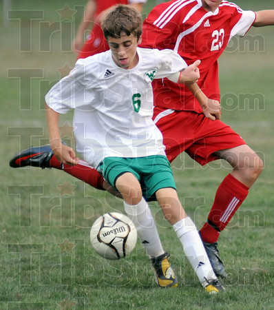 Kump brothers: West Vigo's #6, Nathan Kump defends against a Terre Haute South player during game action.