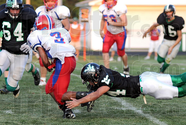 Shoestring tackle: West Vigo's #44, Ryan Roach gets a shoestring tackle on LInton quarterback #3, Evan Magni during first half action Friday night.