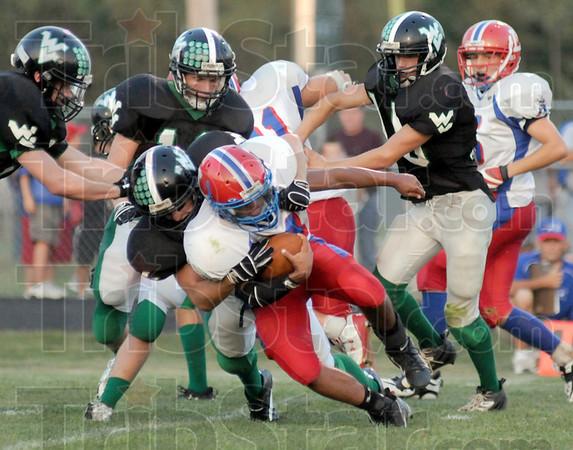 Swarming defense: Linton quarterback #3, Evan Magni gets swarmed by the West Vigo defense durng game action Friday night.