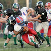 Swarming defense: Linton quarterback #3, Evan Magni gets swarmed by the West Vigo defense durng game action Friday night.