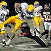 Gotcha: South's #28, Tyler Evans puts the stopper on Carmel's #9, Zach Hughes during game action Friday night.
