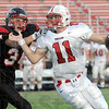 Gotcha: South's #34, Logan Buske gets to Center Grove quarterback Kyle Barth during first half action Friday night.