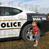 Kid's Day: Toddler Liam Frankel checks out the police cruiser at the Kid's Day event at the Vigo Co. Fairgrounds Saturday morning.