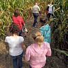 Maze: A small group walks through one of the mazes at Pumpkin Works Saturday morning.
