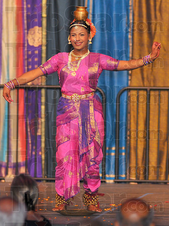 Well balanced: This dance, the Kuchipudi, is performed partly while the dancer balances on a brass dish with an urn of water on her head.
