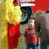 Chicken man: Eleven-year-old Darius Brown adjusts his beak under the watchful eye of twenty-month-old Liam Frankel at the Kid's Day event at the Vigo Co. Fairgrounds sponsored by Anderson Chiropractic to raise money for Ryves Hall.