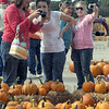 Picture this: Several parents check-out photographs of their children while visiting the Pumpkin Works Saturday morning.