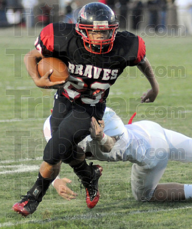 Yardage: South's #23 Tre Stephens slips a tackle during game action against Center Grove Friday night.