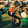 Drawing a crowd: South Vermillion runningback Nick Alfke(36) is hauked down by Viking defenders Josh Hubbard(45), Cole Lydick(21) and Brandon Blystone(52).
