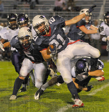 Stopped: Patriot runningback Daniel Gabbard is stopped by Ben Davis' Brandon Cooly