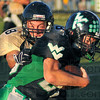 Not so fast: Wildcat defender Cody Mumaw(8) grabs West Vigo's Cole Lydick from behind in first half action on the Viking's field.