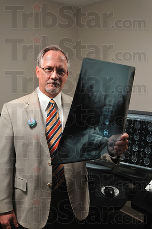 Tribune-Star/Joseph C. Garza<br /> From film to digital: Even though film is still used, X-rays are read by digital display about ninety percent of the time now at Terre Haute Regional Hospital. Here, Bruce Adamson, director of radiology at Terre Haute Regional Hospital, displays examples of both.