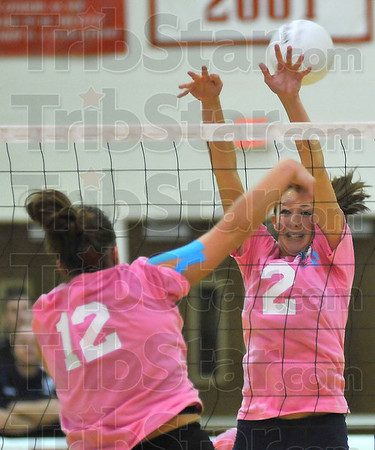 Can't stop: Lady Patriot Kristin Moss(2) can't stop a spike by Terre Haute South's Taylor Hayne.