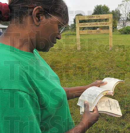 Right here: Marsha Ladd's family now owns the property where the Joseph Jackson School once stood. Here she holds the abstract recording the history of her land.
