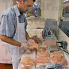 Well known: J.B. McFall cubes chicken breasts in Mike's Market. A long-lived Terre Haute grocery store known for its meat department.