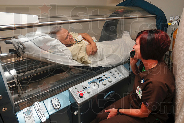 Tribune-Star/Joseph C. Garza<br /> Advanced care: Certified Hyperbaric Technologist Christina Marietta talks with patient, Dan Nickelson, of Coalmont as he relaxes in a hyperbaric chamber during oxygen therapy Thursday, Sept. 10 in the hospital's Wound Center.