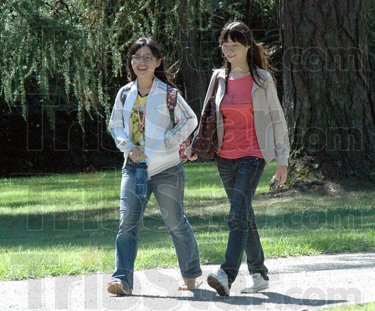 Tribune-Star/Bob Poynter<br /> International walk: Wan-Chun Ho and Yen-Fang Chen walk across the St. Mary's campus Monday afternoon enroute to the dining hall for lunch.
