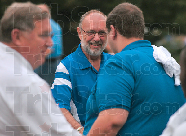 Tribune-Star/Joseph C. Garza<br /> Indiana State University President Dan Bradley greets a freshman during a welcoming ceremony Sunday, Aug. 23 near the intersection of Third and Cherry Streets on the Indiana State campus.