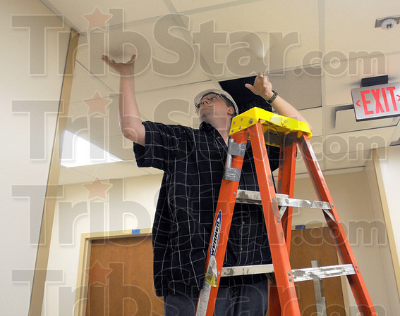Tribune-Star/Bob Poynter<br /> Installation: Joink, Inc. employee Michael Harazin installs electronics in the ceiling of the new Union Hospital Tuesday, Sept. 8.