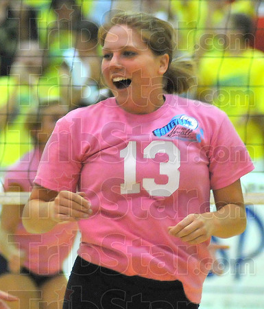Time to smile : Jessica Chichester smiles after scoring a point against Terre Haute North Friday night in the Lady Braves' gym.