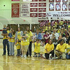 Recognized: Families that have been helped by the Union Hospital NICU and some of the staffers there assembled for a group photo between games at the North-South Volleyball match Friday night.