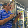 Third generation: Steve Nasser takes notes in his grocery store, Mike's Market.