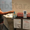 Tribune-Star/Joseph C. Garza<br /> Keeping them clean: Indiana State senior Leann Martinez of Whiting takes advantage of the free hand sanitizer provided by the university Friday on campus.