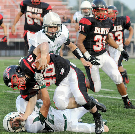Smackdown: South's #20, running back P.J. Montgomery runs over a Vincennes defender during first quarter action Friday night.