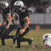Tribune-Star/Joseph C. Garza<br /> Knight escapes Knight: Northview's Drake Stevenson escapes the grasp of Terre Haute North's David Knight as he runs through the Patriot defense Friday in Brazil.