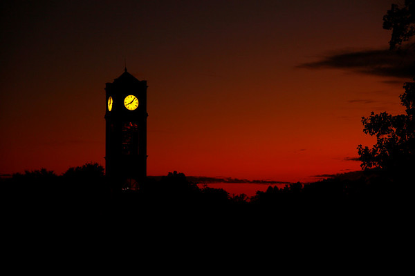 View of the clock tower during a summer sunset on the Gardner-Webb campus.