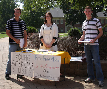 Young Americans for Liberty visited campus to meet up with some student members of their organization. They set up in the quad to recruit new members. The members visiting are Tyler Millage[far left] and Amanda Prevette [middle].  Jacob Vandenbark is on the right talking to the Yaliberty proponents.