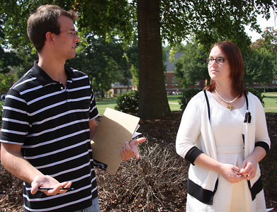 Young Americans for Liberty visited campus to meet up with some student members of their organization. They set up in the quad to recruit new members.The members visiting are Tyler Millage[far left] and Amanda Prevette [right].