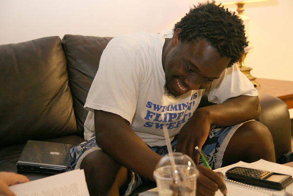Danaj Seymour laughs at a complex problem as he studies physics with a group of friends in the HAPY lobby Sunday night.