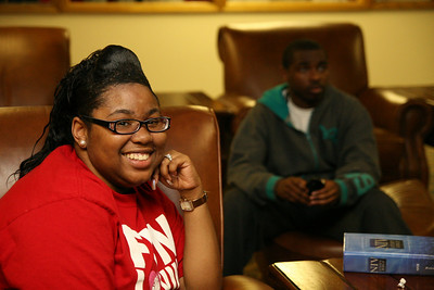 Freshman Xenia Johnson smiles for the camera while hanging out with freshman Canaan Grier (background) and friends Friday night in the DCC.