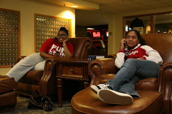 Freshmen Xenia Johnson (left) and Ebony Williams relax in the DCC Friday night.