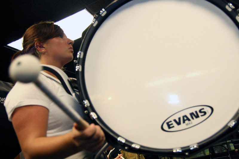 Third bass drummer Lauren Fletcher concentrates during rehearsal on Wednesday.