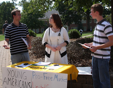 Young Americans for Liberty visited campus to meet up with some student members of their organization. They set up in the quad to recruit new members.The members visiting are Tyler Millage[far left] and Amanda Prevette [middle].  Jacob Vandenbark is on the right talking to the Yaliberty proponents.