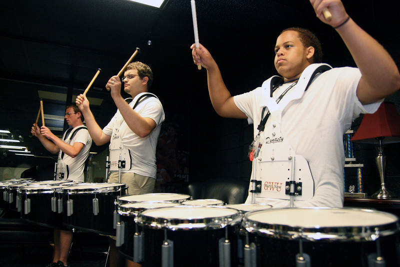 The tenor line pauses for a visual during rehearsal Wednesday afternoon. The drumline rehearsed in the Bulldog Suite above the LYCC due to the rain.