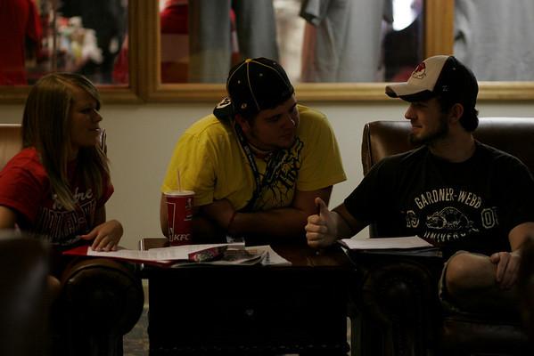 Freshman Ashton Mallosh, Tevor Gosselan, and Adam Barns study together near the campus shop.