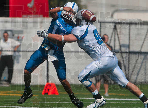 Tribune-Star/Joseph C. Garza<br /> Hurried: Indiana State quarterback Travis Johnson is forced to get rid of the ball as he was rushed by Eastern Illinois defensive lineman Michael Letton Saturday at Memorial Stadium.