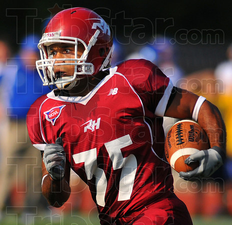 Looking to run: Engineer wide reciever Reed Eason looks upfield against the visiting North Park team Saturday afternoon.