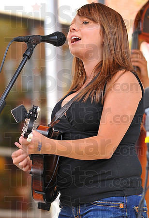 Daytime blue grass: Hardline Drive vocalist and mandolin player Danielle Smith sings for a daylight crowd at the Ninth annual Blues at the Crossroads Saturday.
