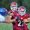 Go away: Rose-hulman runingback Kyle Kovach(22) stiffarms Viking defender Nick Panteleo for more yardage.