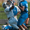 Tribune-Star/Joseph C. Garza<br /> Going their way: Eastern Illinois wide receiver Lorence Ricks makes a stunning catch as he falls backwards over Indiana State's Mike Woods (11) as fellow Sycamore Donye McCleskey backs off after a flag was thrown Saturday in the first quarter of action at Memorial Stadium.